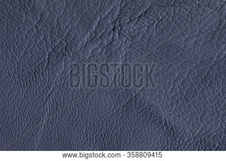 The Texture Of Genuine Leather Close-up. Genuine Leather Is Painted Red For Sewing Outerwear, Shoes