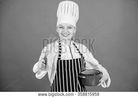 Girl In Apron Whipping Eggs Or Cream. Start Slowly Whisking Whipping Or Beating Cream. Use Hand Whis