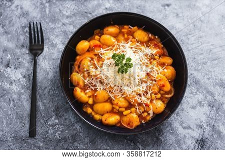 Plant-based Food, Potato Gnocchi With Eggplant Capsicum Sauce And Vegan Cheese Topping