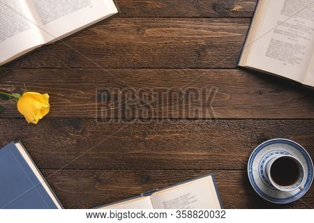 Books With Poems, Cup Of Coffee, Rose, On Wooden Background. Flat Lay, Top View, Copy Space.