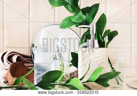 Bathroom Shelf With Green Natural Plant Leaves Decor, Soap Dispenser, Beige Tile, Eco Styled Colors.