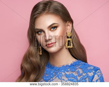 Brunette Girl With Perfect Makeup. Beautiful Model Woman With Curly Hairstyle. Care And Beauty Hair