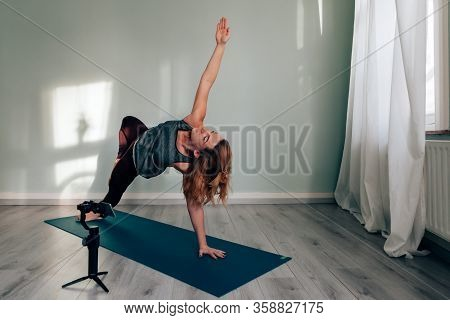 Female Yoga Teacher Connected From Home Blogging And Vlogging Broadcasting Lesson Via Social Media U