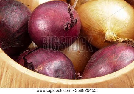Red And White Onions Lying In A Storage Pot Of Earthenware To Keep Them Fresh And Dry