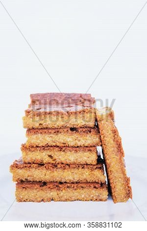 Stack Of Delicious Freshly Baked Blondie Brownie Dessert Slices On White Background.