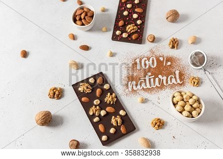 Homemade Natural Dark Chocolate Bars And Nuts On White Background. Side View, Copy Space For Text. C