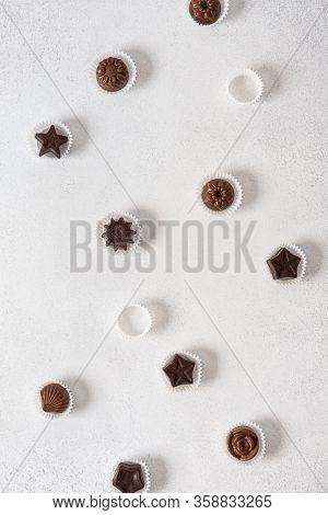 Homemade Dark And Milk Chocolate Pralines Candies On White Background. Top View, Flat Lay. Chocolati