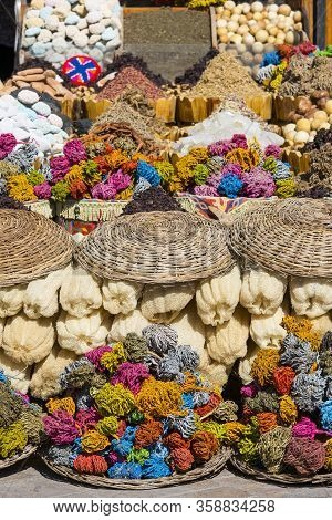 Colored Natural Pumices Stones And Dried Marine Algae At The Stand On Street Bazaar In Egypt