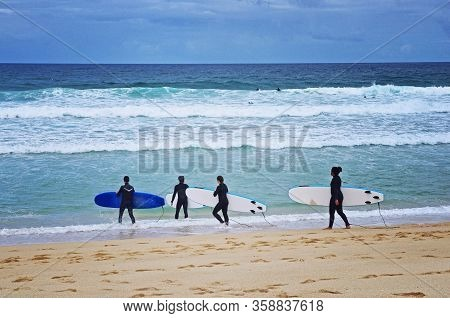 Beginner Surfers On The Beach. Surfing Lesson. Love Surfing. Surf School. Four Friends Going Surfing