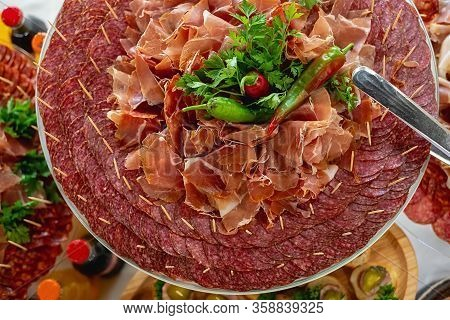 Top View Of Banquet Table With Cold Snacks, Cold Meats, Sliced Sausages. Delicious Snack, Appetizer