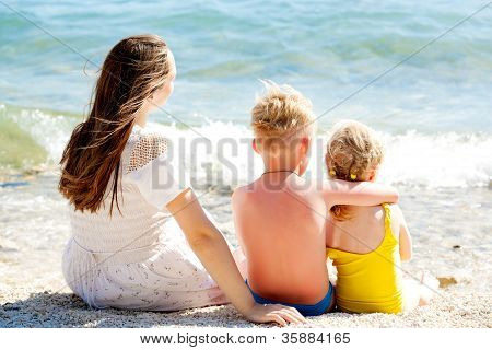 Family relaxing on the beach