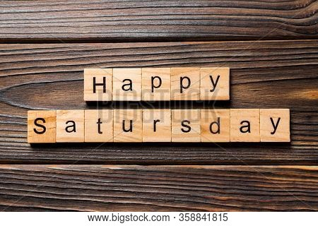Happy Saturday Word Written On Wood Block. Happy Saturday Text On Wooden Table For Your Desing, Conc
