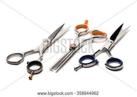 Hairdresser master scissors isolated on white.
