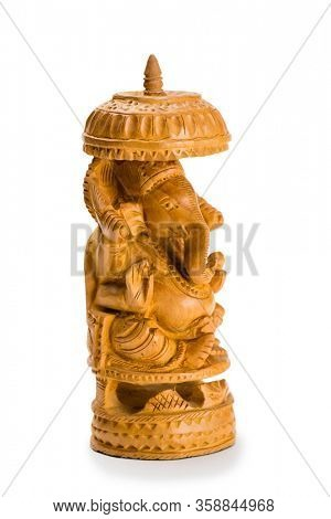 Miniature wooden sculpture depicting an elephant isolated on white.