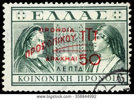 Luga, Russia - October 15, 2019: A Stamp Printed By Greece Shows Image Portraits Of Queen Olga And Q