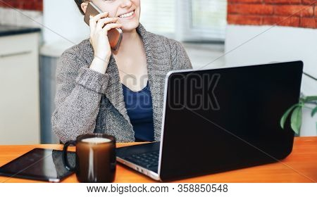 Young Beautiful Girl Working At Home At Table In Front Of Laptop, Working During Quarantine, How To