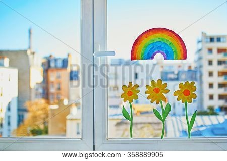 Colorful Rainbow And Yellow Flowers Painted On Window Glass In Parisian Apartment, View To Residenti