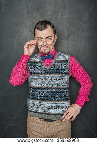 Strict Teacher Vintage Style In Eyeglasses Looking At You On Blackboard