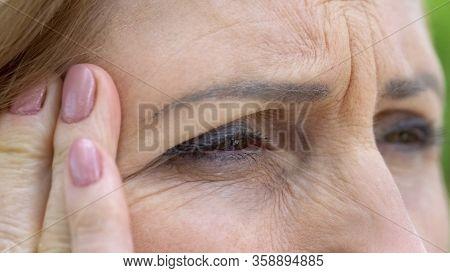 Senior Woman Suffering Eyesight Problems, Cataract Disease, Vision Correction
