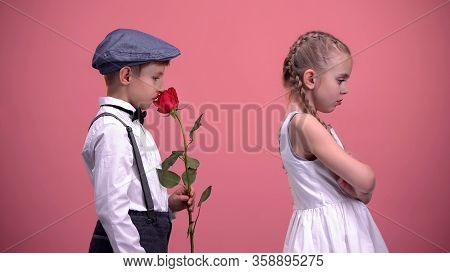 Gentleman Boy With Red Rose Apologizing To Offended Girlfriend, First Love
