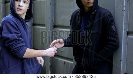 Teenager Buying Narcotics From Black Dealer, Illegal Drug Trafficking, Abuse