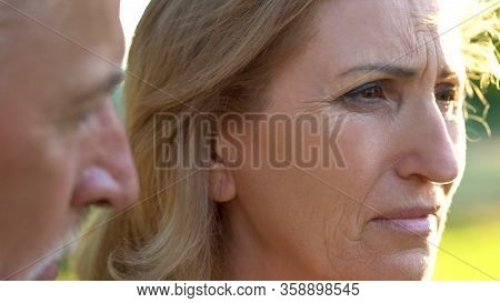Old Male Supporting His Upset Wife After Bad News About Incurable Disease