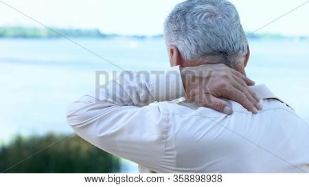 Mature Man Massaging Neck And Shoulders, Aging Health Problem, Painful Injury