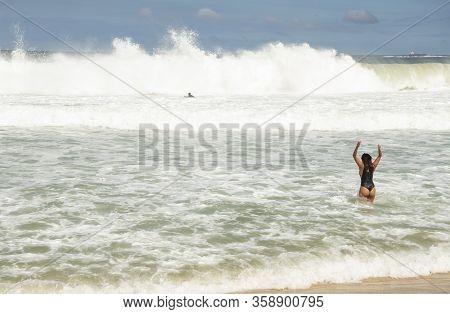 Rio De Janeiro, Brasil-  February 28, 2020: Citizens Swim E On The Beach Of Copacabana