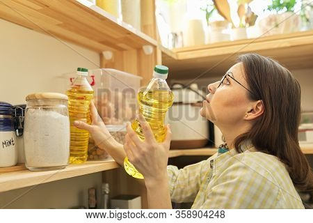 Food Storage, Wooden Shelf In Pantry With Products. Woman Taking Food, Sunflower Oil For Cooking.