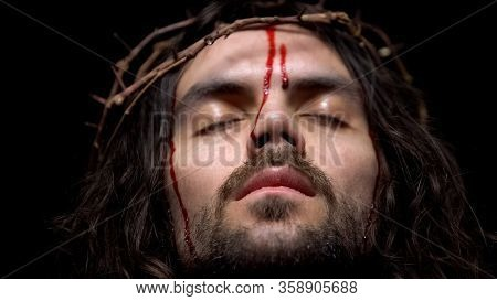 Closeup Of Bloody Jesus Head With Crown Of Thorns, Crucifying Christ, Agony