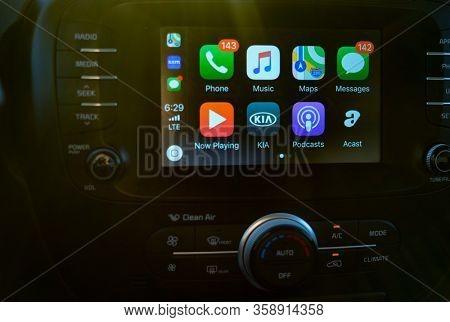 Phoenix, Az-USA 8.14.19: Apple CarPlay on screen of Kia Soul car dashboard. CarPlay is an Apple App that is controlled via iPhone.