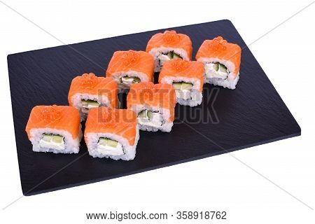 Traditional Fresh Japanese Sushi Rolls On Black Stone Philadelphia Ikura On A White Background. Roll