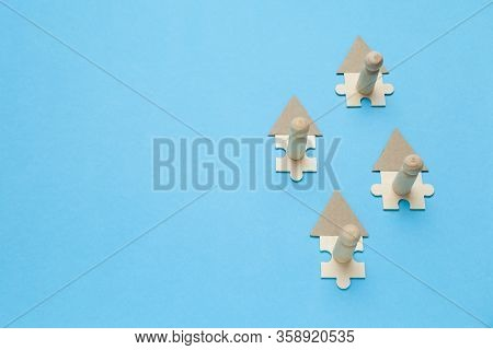 Wooden Figures Working Online In House On Blue Background. Freelance Workplace At Home, Teleworking.