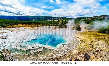 Steam Coming From The Turquoise Waters Of The Artemisia Geyser Hot Spring In The Upper Geyser Basin