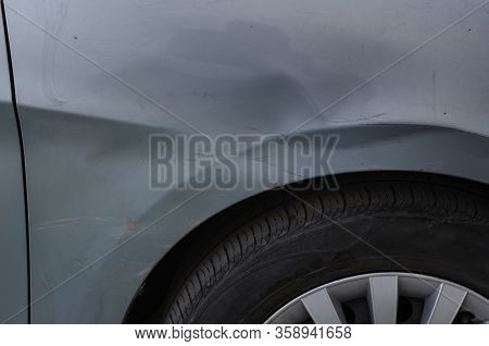 Traffic Incident Part 2. Damaged Sedan Body. The Front Right Wing Of A Passenger Car With Traces Of