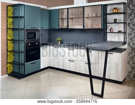 Upscale Aqua Menthe Kitchen In Luxury Home With Breakfast Bar Counter Flat Wooden Panels Design.