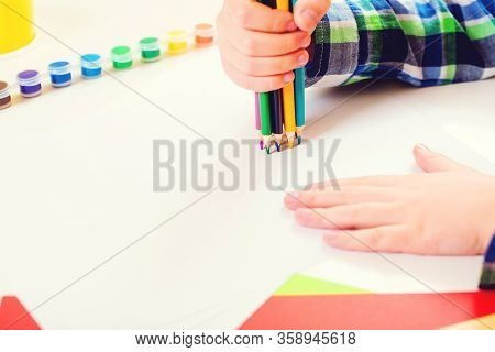 Cute Child Drawing At Home, Top View. Kid Hands Holding Many Color Pencils. Copy Space. Kids Creativ