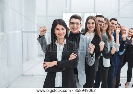 Group Of Happy Young People Standing In A Row