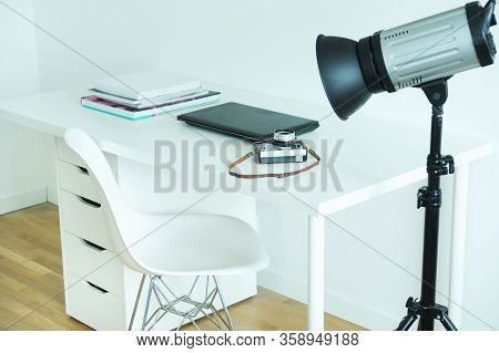 Photographer's Workplace With Laptop And Camera.photographer's Workplace With Laptop And Camera.the