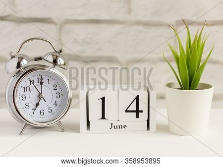 June 14 According To The Wooden Calendar. Summer Day, Empty Space For Text.calendar For June On A Li
