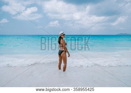 Petite Anse Mahe Seychelles, Young Woman On The Beach, Mid Age Asian Woman Walking On Tropical Beach