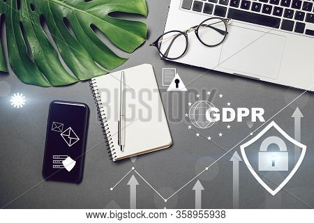 Cyber Internet Security Concept. Gdpr And Cybersecurity. Top View Of Laptop, Monstera Leaves, Notebo