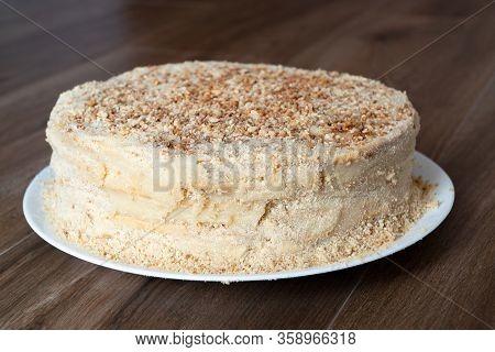 Napoleon Cake On A Wooden Table. Dessert Napoleon Cake Close-up.