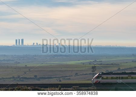 26-12-2018. Madrid, Spain. Madrid Commuter Train. Landscape With Madrid City Skycrapers On The Skyli