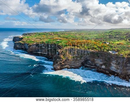 The Sheer Cliffs Of The Southern Coast Of Bali Are Washed By A Clear Azure Ocean. Bukit Peninsula Ae