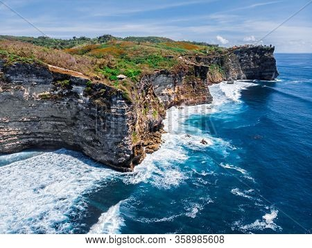 Rocks Of The Coast Of The Bukit Peninsula In Bali. The Sheer Cliffs Of The Southern Coast Of Bali Ar