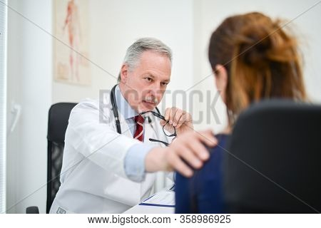Doctor encouraging an ill patient in his studio