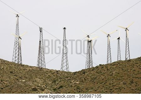 Forgotten Abandoned Vintage Wind Turbines Which Once Created Green Alternative Energy Taken On An Ar