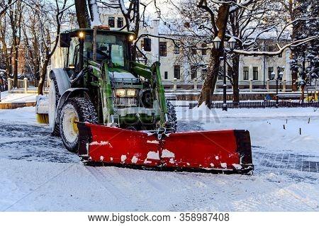 Latvia, Riga, December, 2018 - Snowplow Truck Removing Snow In Riga City Park, Latvia