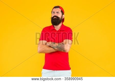 Schedule Your Tattoo Session. Hipster With Ink Tattoo Yellow Background. Bearded Man Wear Tattoo Cov